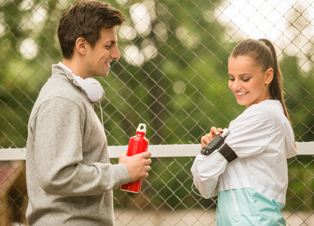 scamper: Young people in sports wear are relaxing and talking during the morning scamper. Stock Photo