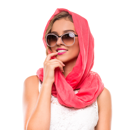 Portrait of a young woman in bright crimson headscarf and sunglasses. Beauty, fashion. Stock Photo