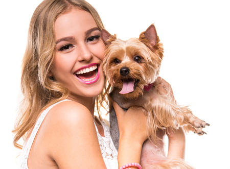 yorkie: Beautiful young girl with cute yorkshire terrier dog, isolated on white.