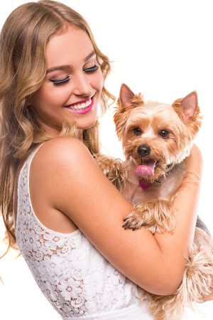 personas abrazadas: Beautiful young girl with cute yorkshire terrier dog, isolated on white.