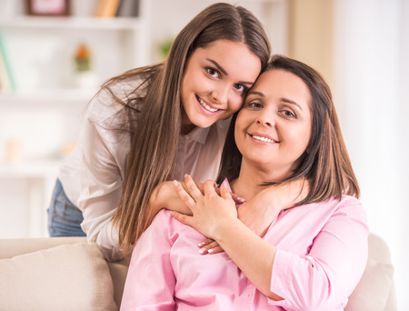 family portrait: A happy family. Mother and teen daughter at home. Stock Photo