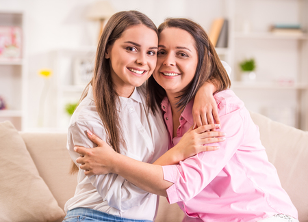 A happy family. Mother and teen daughter at home. Stock Photo