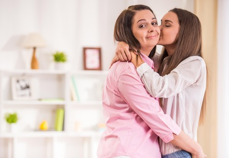 pretty teen: A happy family. Mother and teen daughter at home. Stock Photo