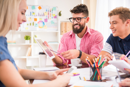 talking people: A group of young people working in the office Stock Photo