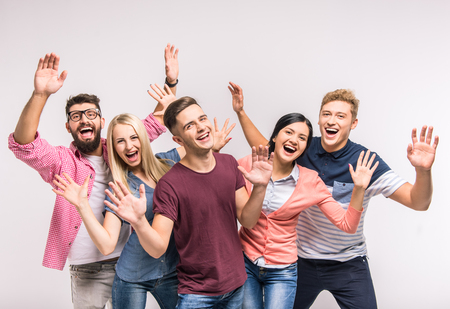 Funny young people on a gray background