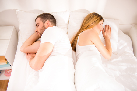 divorce: Young couple sleeping in bed back together