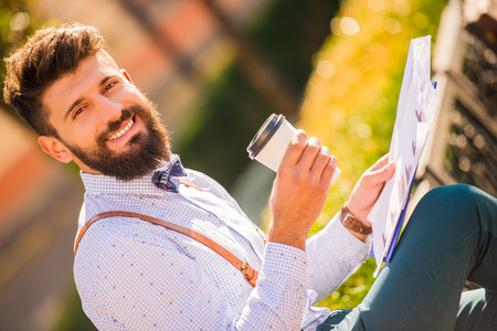 young young: Stylish young man with a beard, a walk in the park