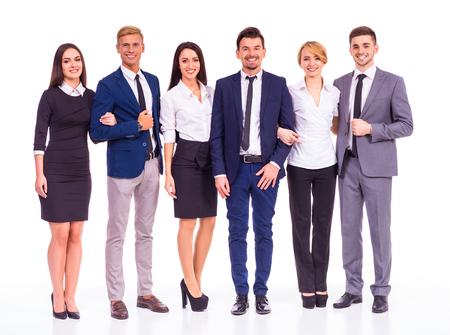Eine Gruppe von jungen Geschäftsleuten lächelnd auf einem weißen Hintergrund. Studioaufnahmen Standard-Bild - 46490865