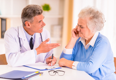 Caring for a sick senior woman in hospital Archivio Fotografico