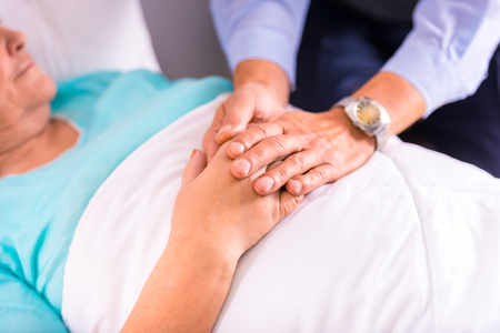 age old: Caring for a sick senior woman in hospital Stock Photo