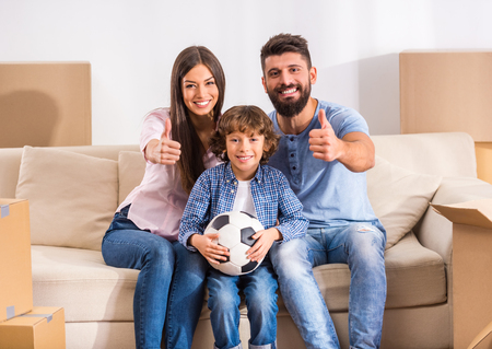Young happy family moving to a new home Stock Photo