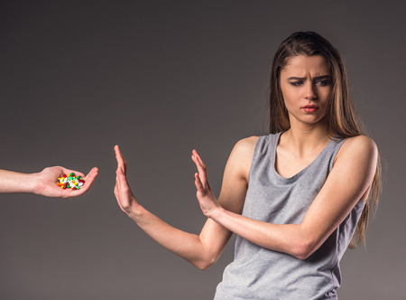 The social problem. Young unhappy woman, rejection of bad habits Stock Photo