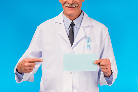 urologist: The social problem of male diseases. Portrait of a doctor with a blue ribbon. Isolated on a blue background