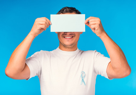 urologist: The social problem of male diseases. Portrait of a man with a blue ribbon. Isolated on a blue background Stock Photo