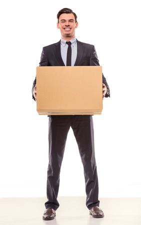 moving box: Young happy businessman with box for moving into a new office. Studio shot, isolated on a white background