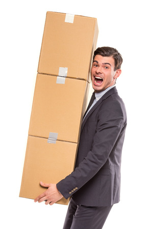 moving office: Young happy businessman with box for moving into a new office. Studio shot, isolated on a white background