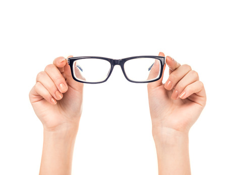 doctor giving glass: Female hand holds glasses isolated on a white background