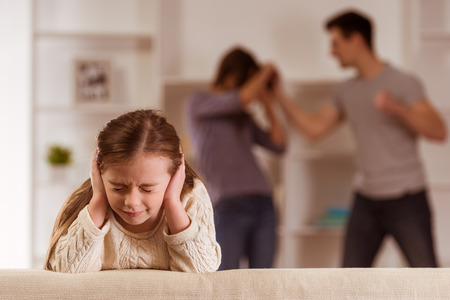 girl fight: ?hild suffering from quarrels between parents in the family at home