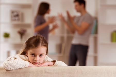 family with one child: ?hild suffering from quarrels between parents in the family at home