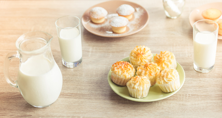 recently: Recently baked muffins and fresh milk on the table