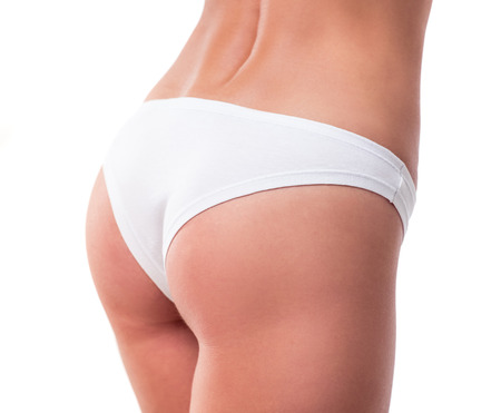 booty: Beautiful girls booty in white panties, isolated on white Stock Photo