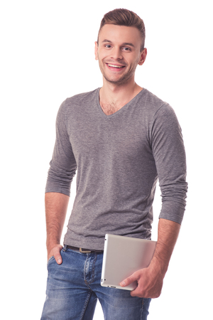 sudadera: Handsome young man in casual clothes is holding a digital tablet, looking at camera and smiling, isolated on white