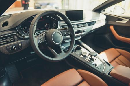 Visiting car dealership. Interior of modern automobile presented in dealership Stock Photo