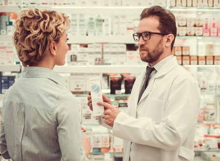 skill: Handsome pharmacist is suggesting a medicine to a beautiful female client at the pharmacy