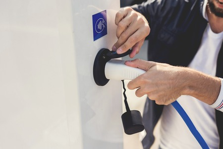 The electric machine stopped at the charging station to recharge.