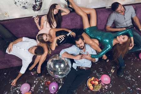 Young people are resting after a tumultuous party in a nightclub. Reklamní fotografie