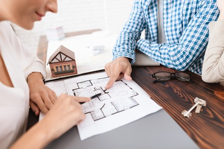 A young couple chooses a house for their family. Stock Photo