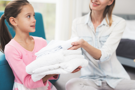 The daughter helps the mother with household chores. Stock Photo