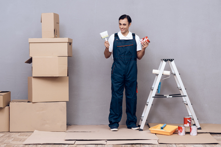 Man of Arab appearance works as a painter. A man is painting walls. He is wearing a special uniform. Reklamní fotografie