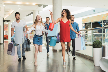 Sale in black Friday. The company of young people are engaged in shopping on a black Friday.