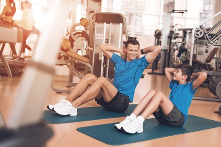 Dad and son in the same clothes in gym. Father and son lead a healthy lifestyle. Stock fotó