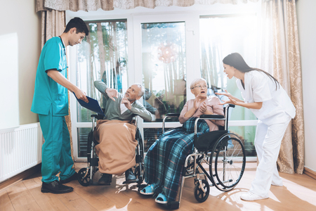 Medical workers argue with an elderly couple in a nursing home.