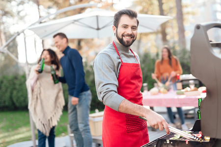 A man is cooking barbecue food.