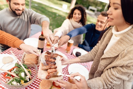A company of young people came together for a barbecue.