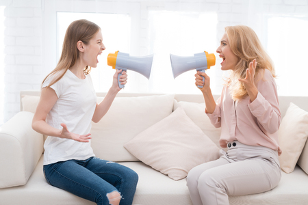 Mom and a teenage daughter are arguing with each other.