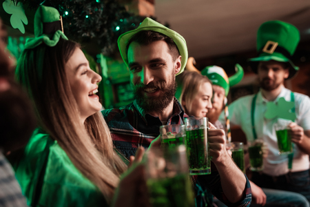 The company of young people celebrate St. Patricks Day. Stock Photo