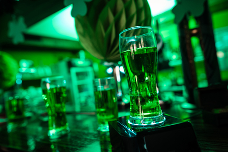 A glass of beer is on the bar. Stok Fotoğraf