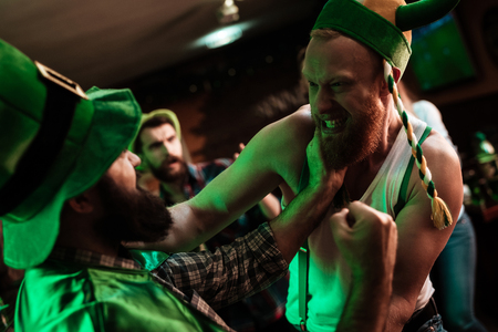 Two men fight in a bar.