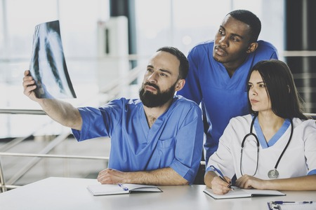 The doctors looking at an x-ray results in hospital.