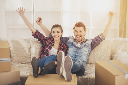 The young happy couple. Moving, purchase of new habitation. Stock Photo