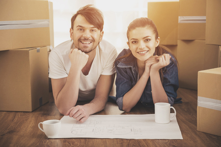 The young happy couple planning a new house. Moving, purchase of new habitation.