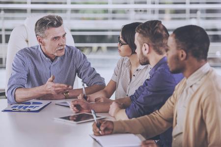Group of business people having meeting in office. Standard-Bild