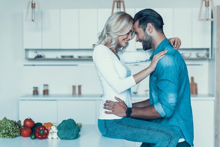 Romantic couple preparing breakfast together in kitchen. Family of vegans. Vegetarianism concept. Close relationship.
