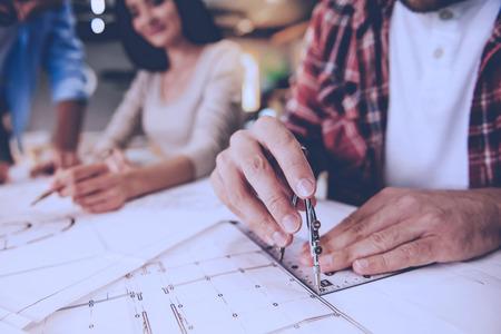 Cropped image of designers working on drafts in studio 版權商用圖片