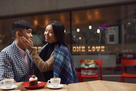 Happy couple in a cafe. Wedding proposal concept. Stockfoto