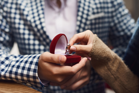 Close up. Man makes proposal of marriage to girl. Love story.
